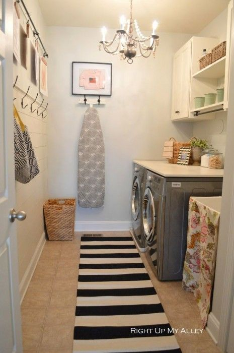laundry room with chandlier